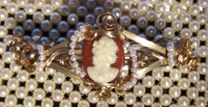 White on carnelian cameo barrette
