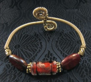 Red lampwork beads and gold filled wire bangle