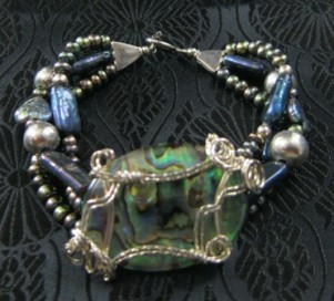 Abalone, pearl, and sterling silver bracelet