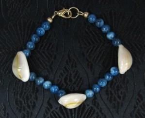 Blue apatite gemstone and shell bracelet