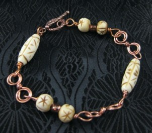 Carved bone beads and copper wire bracelet