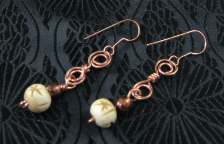 Carved bone and copper wire earrings