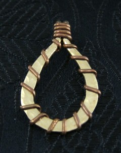Gold and copper hand forged pendant