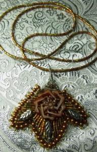 New jade carved filigree & seed beed pendant