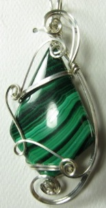 Malachite shield in sterling silver hand sculpted pendant