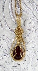 Hand sculpted pear shaped ruby necklace