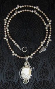 Silver wrapped cameo and pearl necklace