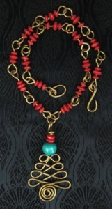 Brass wire tree with red and green wood beaded necklace