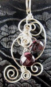 Faceted garnet teardrop sterling silver pendant