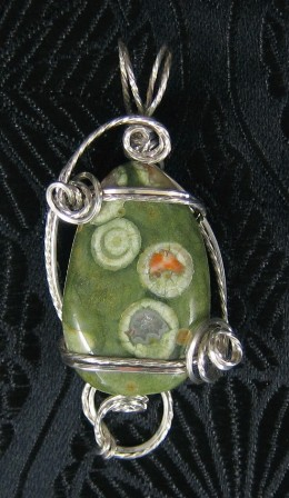 Tumbled rhyolite gemstone and sterling silver pendant