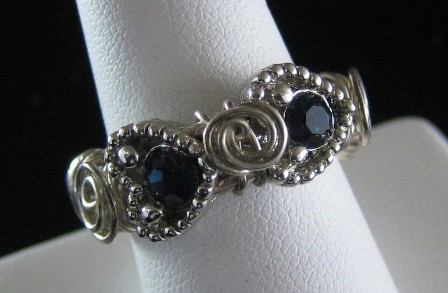 Sterling silver heart shaped blue crystal slider beaded ring