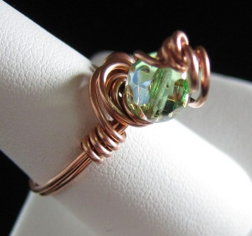 Hand sculpted copper wire with green Czech bead ring