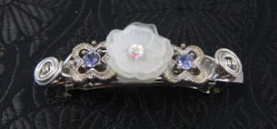 White resin flower and two blue crystal slider beads silver barrette
