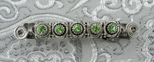 Green crystal slider beads and silver wire barrette