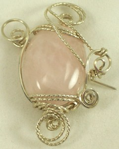 Rose quartz gemstone and sterling silver brooch